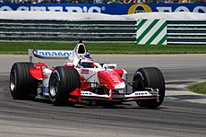 Olivier Panis driving the Toyota TF104 at the 2004 United States Grand Prix at Indianapolis. He finished the race in 5th.