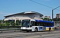 TriMet 2012 Gillig BRT bus with Rose Garden arena.jpg