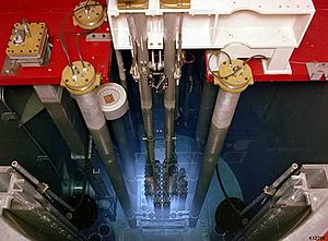 Radiant energy - Cherenkov radiation glowing in the core of a TRIGA reactor.