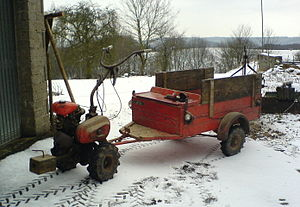 Two-wheel tractor - A Hako two-wheel tractor with trailer.