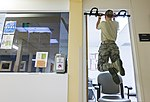 U.S. Air Force Senior Airman Megan Stanton, a medic with the 366th Medical Operations Squadron, performs pullups in the urgent care center at Mountain Home Air Force Base, Idaho, July 15, 2013 130715-F-NW635-114.jpg