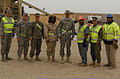 U.S. Army Brig. Gen. Francisco Espaillat, center right, the commander of the U.S. Central Command Deployment and Distribution Operations Center, poses for a photo with members of the Defense Logistics Agency 140103-D-ZZ999-001.jpg