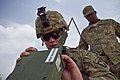 U.S. Army Spc. Christian Walker, left, a cavalry scout with the 1st Squadron, 61st Cavalry Regiment, 4th Brigade Combat Team, 101st Airborne Division, puts a radio into operation while Spc. Evins Pierre observes 130714-A-DQ133-513.jpg