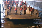 U.S. Sailors, assigned to the amphibious assault ship USS Bataan (LHD 5), lower the roll-on-roll-off ramp of an improved navy lighterage system before unloading equipment into the ship's well deck during 080922-N-IF140-120.jpg