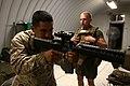 U. S. Marine Sgt. Julian Bejarano, joint fires observer, teaches combat marksmanship to Lance Cpl. Gregory Limbaher, nuclear biochemical defense specialist, with Combat Logistics Regiment 2, 2nd Marine Logistics 120901-M-KS710-001.jpg