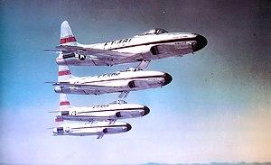 Echelon formation - Four Lockheed F-80 aircraft in echelon left formation