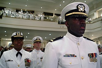 Reserve Officers' Training Corps - Newly graduated and commissioned officers of the Naval Reserve Officers Training Corps (NROTC) Unit Hampton Roads stand at attention as they are applauded during the spring Commissioning Ceremony in May 2004.
