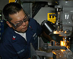 USS Nimitz Sailor constructs parts for fighter jet DVIDS88366.jpg