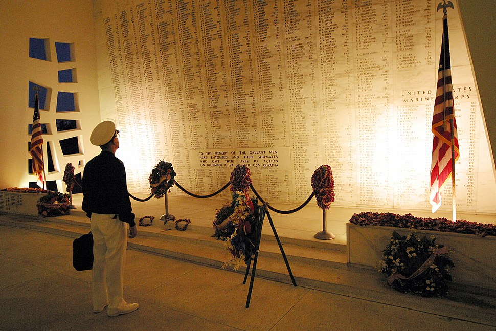 US Navy 021205-N-3228G-003 A participant of the upcoming Dec. 7th USS Arizona commemoration ceremony, scans the 1177 names of Arizona crewmembers on the huge marble wall in the shrine room of the memorial prior to rehearsal