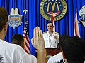 "US Navy 030501-N-4518L-003 Admiral Robert J. Natter, Commander, U.S. Atlantic Fleet, administers the Oath of Enlistment to 40 new Navy recruits during ""Fleet Week USA."".jpg"