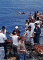 US Navy 030608-N-7902K-024 Sailors aboard the guided missile cruiser USS Antietam (CG 54) enjoy a swim call and a steal beach picnic in the warm waters of the Western Pacific.jpg