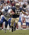 US Navy 031004-N-9818S-635 Navy fullback Kyle Eckel outpaces Air Force defender Marchello Graddy for yardage.jpg