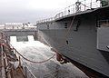 US Navy 040830-N-4649C-002 Water is allowed to fill the dry dock facility supporting the amphibious command ship USS Blue Ridge (LCC 19).jpg