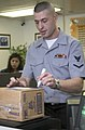 US Navy 050209-N-9851B-001 Ship's Serviceman 3rd Class John Lester of Oklahoma City, Okla., marks a package for delivery at the Post Office Customer Service Counter on board Commander Fleet Activities Yokosuka, Japan.jpg
