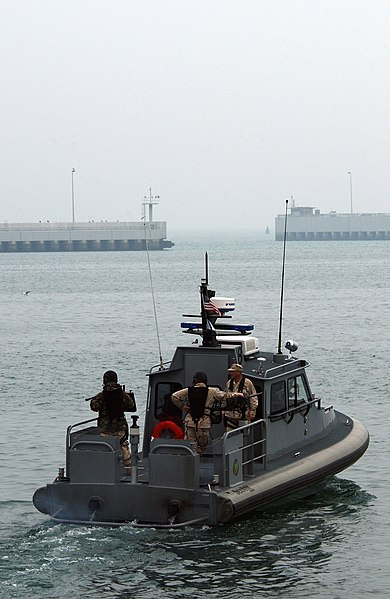 File:US Navy 050222-N-6932B-008 Personnel assigned to Inshore Boat Unit Two Two (IBU-22), Naval Coastal Warfare (NCW) Squadron Two Five, exit the harbor at Kuwait Naval Base beginning their security patrol.jpg