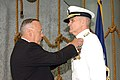 US Navy 050812-N-3429E-002 Assistant Secretary of Defense for Reserve Affairs Thomas F. Hall pins the Distinguished Service Medal on Rear Adm. John P. Debbout.jpg