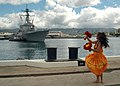 US Navy 060905-N-4965F-003 A Polynesian dancer welcomes home Sailors from the guided missile destroyer USS Russell (DDG 59) after returning from a six-month deployment.jpg