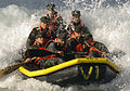 US Navy 070202-N-5169H-476 Basic Underwater Demolition-SEAL (BUD-S) students ride a wave in on their inflatable boat.jpg