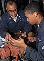 US Navy 080718-N-6999H-039 Machinist's Mates work to rebuild a waste water pump.jpg