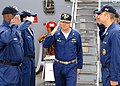 US Navy 080724-N-1082Z-008 Capt. Robert Irelan, commanding officer of the multi-purpose amphibious assault ship USS Iwo Jima (LHD 7), salutes while passing through side boys.jpg