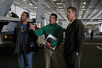 Vince Ferragamo - Ferragamo touring the USS Ronald Reagan (CVN-76) with Buffalo Bills player Andre Reed in 2009