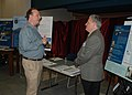 US Navy 090506-N-0000L-001 Naples resident Bob Baldwin discusses air quality with subject matter expert Joe Lucas during an informational Open House at Ciao Hall at Naval Support Activity Naples.jpg