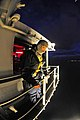 US Navy 100315-N-6006S-697 Quartermaster 3rd Class Daniel Gastaldi prepares to wash windows in the early morning hours as the aircraft carrier USS Carl Vinson (CVN 70) transits the Strait of Magellan.jpg