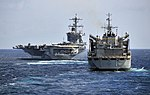 US Navy 100326-N-4774B-106 The Military Sealift Command fast combat support ship USNS Rainier (T-AOE 7) approaches the Nimitz-class aircraft carrier USS Carl Vinson (CVN 70) during an exercise with the guided-missile cruiser US.jpg