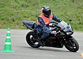 US Navy 100513-N-5538K-002 Chief Master-at-Arms Aaron Mitchem, assigned to the security department at Fleet Activities Sasebo, participates in a motorcycle safety class at the Akasaki Motorcycle Range.jpg