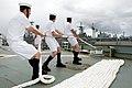 US Navy 100626-O-8247T-052 Sailors assigned to the Royal Australian Navy amphibious landing platform HMAS Kanimbla (L 51) handles the mooring line as the ship pulls into Pearl Harbor, Hawaii.jpg