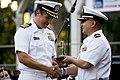 US Navy 100704-N-8863V-530 Capt. Jay Kadowaki, commanding officer of Naval Surface Warfare Center (NSWC), Corona Division, presents Fleet Liaison Officer Lt. Tin Tran with the community Guardian of Freedom award.jpg