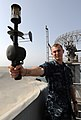 US Navy 100918-N-4135M-074 Aerographer's Mate 3rd Class Dale Gartin, from La Grange, Texas, uses an anemometer to measure the relative winds during.jpg