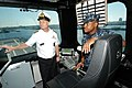US Navy 101012-N-6125G-026 Cmdr. Michael Riley, right, commanding officer of the littoral combat ship USS Independence (LCS 2) gives a tour of the.jpg