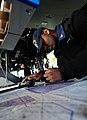 US Navy 101204-N-6006S-049 Quartermaster 2nd Class Lynn Featherstone maps coordinates using navigational aids in the pilot house aboard USS Bunker.jpg