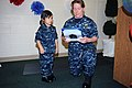 US Navy 110728-N-GW918-002 Cmdr. Jeri O'Neill, director of the career administration division at Navy Personnel Command, reads a citation promoting.jpg