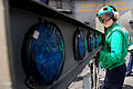US Navy 110801-N-GL340-124 Interior Communications Electrician 3rd Class Bethany Palenik, from St. Louis, disassembles an improved fresnal lens opt.jpg
