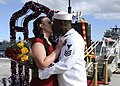 US Navy 110824-N-UK333-077 A Sailor kisses his girlfriend on the pier after returning from a six-month deployment.jpg