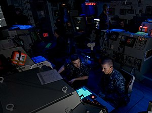 US Navy 120111-N-TZ605-126 Sailors assigned to the operations department aboard the Nimitz-class aircraft carrier USS Carl Vinson (CVN 70), monitor.jpg
