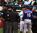 Umpires with Mariners and Rangers coaches.jpg