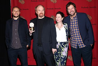 Dave Becky - Becky (right) and other cast and crew members of Louie receive a 2012 Peabody Award on May 20, 2013