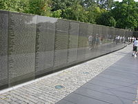 Wall of black granite engraved with names