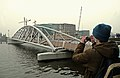 View on the modern foot and bicycle bridge to the Nemo museum; Amsterdam Oosterdok, 2011.jpg