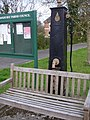 Village pump and bench - geograph.org.uk - 395655.jpg