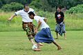 Villagers play football in traditional dress (sarung).jpg