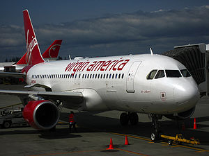 "Virgin America - ""Air Colbert"", the aircraft used on Virgin America's inaugural flight, on the ground at Seattle–Tacoma International Airport"