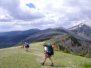 Triple Crown of Hiking - Hikers on the Bob Marshall Wilderness trail. The trail is maintained by The Montana Wilderness Association (CDT Montana).