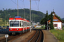 Red-and-white electric train outdoors