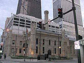 Water Tower Place - View showing the Water Tower Place shopping mall at the base of the skyscraper, with Chicago Avenue Pumping Station in foreground