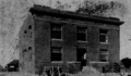 Watts, California, City Hall under construction,1909.png