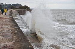 Waves breaking on the sea wall at Teignmouth (0148).jpg